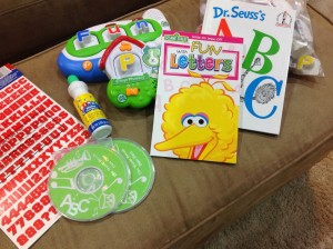 """ABC"" by Dr. Seuss ""Fun with Letters"" Sesame Street dry erase booklet Leap Frog letter and word toys Alphabet stickers Alphabet music on CDs a bingo blotter (I will print out sheets with random letters and have him mark all the ___)"